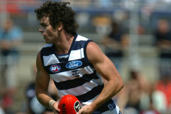 Triple-premiership Cat Matthew Scarlett has resigned as an assistant coach at the club.