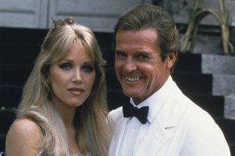 Actor Roger Moore, right, poses with his co-star Tanya Roberts from the James Bond film A View to a Kill.
