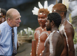 The Duke of Edinburgh talks to Aboriginal performers after watching a culture show at Tjapukai Aboriginal Culture Park, Cairns, 2002.