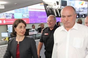 NSW Emergency Services Minister David Elliott walks with Premier Gladys Berejiklian at RFS headquarters in Sydney.