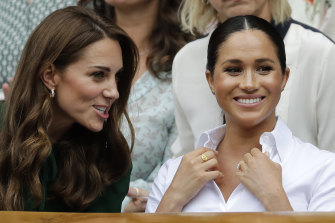 Meghan, Duchess of Sussex, and Catherine, Duchess of Cambridge, at Wimbledon in 2019.