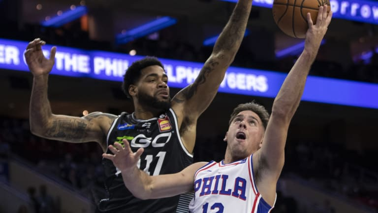 DJ Kennedy defends against Philadelphia 76er  T.J. McConnell.