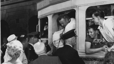 Passengers cram into the last tram to La Perouse on February 25, 1961.