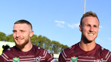 Happier times: Jackson Hastings and Daly Cherry-Evans celebrate at Brookvale.