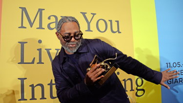 US artist Arthur Jafa holds the Golden Lion.