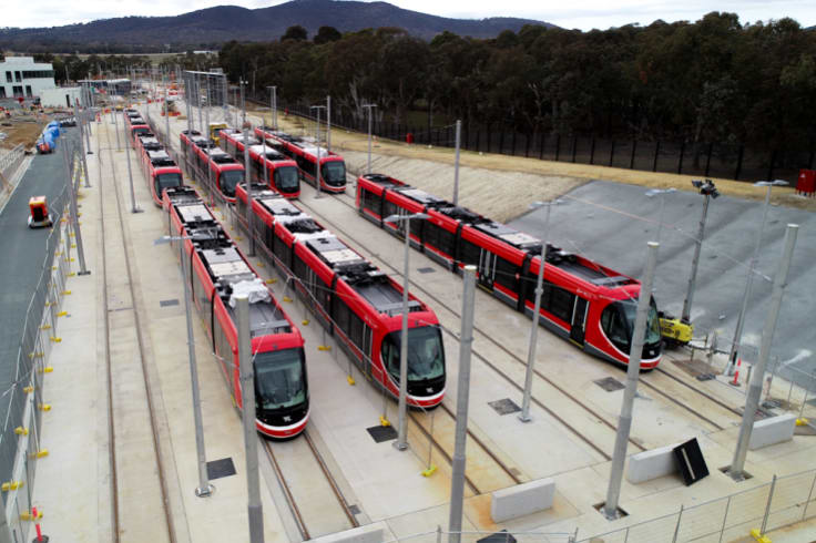 Eight of Canberra's light rail vehicles in the Mitchell stabling yard.