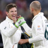 Over and out: Tim Paine and Nathan Lyon celebrate victory on night four, after the Australian spinner claimed the final New Zealand wicket to complete the win.