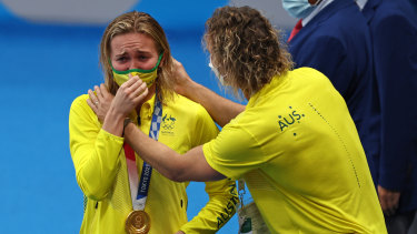 Ariarne Titmus and her coach, Dean Boxall, share a special moment