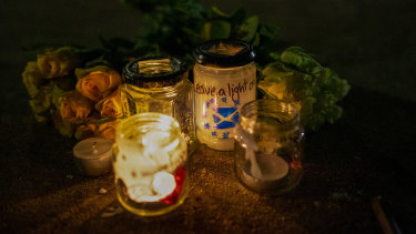 Candles and flowers are left during a gathering entitled 'Missing EU Already' near the Scottish Parliament in Edinburgh.