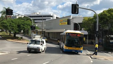 The intersection of High Street and Sherwood Road at Toowong. The proposed development includes the block behind the approaching bus.