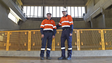 Origin Energy Frank Calabria, chief executive of Origin Energy (right) and Greg Jarvis, executive general manager, energy supply and operations inspecting the Bendeela power station