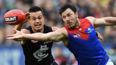 Melbourne's Michael Hibberd battles Blue Jack Silvagni.