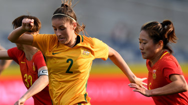 Comeback: Amy Harrison takes on China in her previous stint with the Matildas.