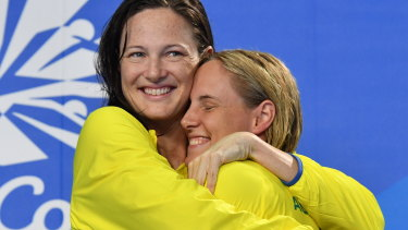 Not so bad when your sister wins: Silver medallist Cate Campbell (left) hugs gold medallist Bronte Campbell  after the 100m freestyle.