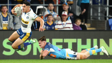 Dylan Brown skips through the tackle of AJ Brimson to score the first try for the Eels.