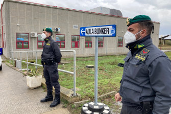 Police officers guard during the first hearing of the 'Ndrangheta crime syndicate trial near the Calabrian town of Lamezia Terme, southern Italy.