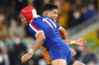 Noah Lolesio is tackled by Gabin Villier in the first Test at Suncorp Stadium.