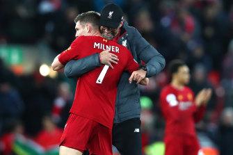 Liverpool manager Jurgen Klopp embraces James Milner after thumping Everton.