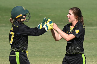 Healy and Georgia Wareham celebrate the wicket of Lauren Down.