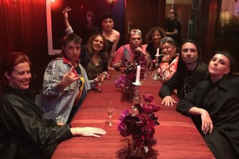 Tracey Moffatt (with hand raised) at a party with Biennale artists in March before the shutdown.