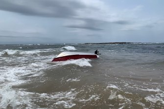 The 12-foot boat overturned after being hit by a rogue wave in calm conditions.