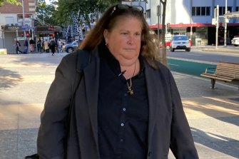 Detective Sergeant Virginia Gray, who led the cold case investigation into the Whiskey Au Go Go arson, leaving the Brisbane Magistrates Court on Thursday.