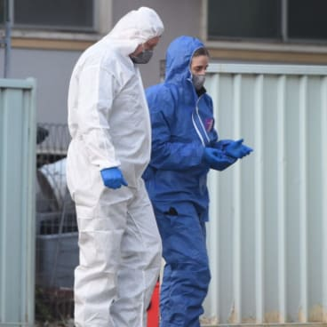 Forensic police examine a home in Lalor Park after a girl was shot dead.