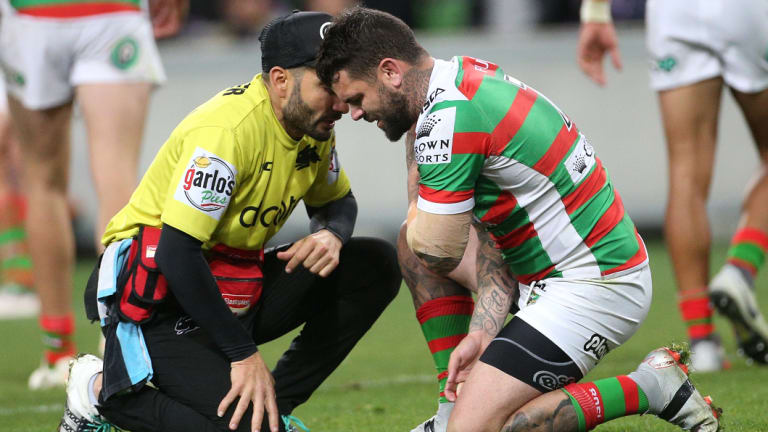 Painful: Adam Reynolds after injuring his shoulder against the Storm.