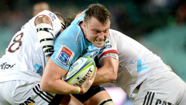 Jack Dempsey hits the Crusaders line hard in an encouraging win for the Waratahs.
