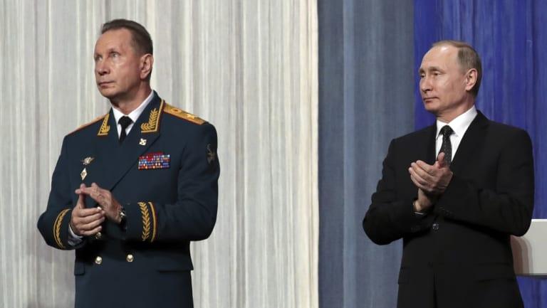 Russian President Vladimir Putin, right,with National Guard chief Viktor Zolotov last year.