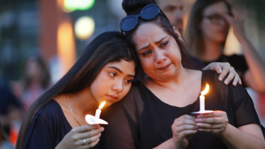 Texans hold candles during a vigil at in McKinney, Texas, after the El Paso massacre.