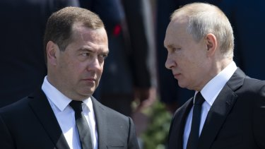 """Russian Prime Minister Dmitry Medvedev left, with Russian President Vladimir Putin is said to have played """"Robin to Putin's Batman""""."""