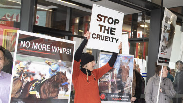 Anti-racing protesters rally outside the premier of the movie Ride Like a Girl.
