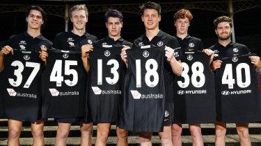 Fresh faces: Carlton's latest pick-ups (L-R) Ben Silvagni, Hugh Goddard, Liam Stocker, Sam Walsh, Finbar O'Dwyer, Tomas Bugg show off their new numbers.