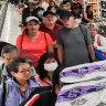 Retail sales slump as coronavirus 'torpedo' hits economy, budget