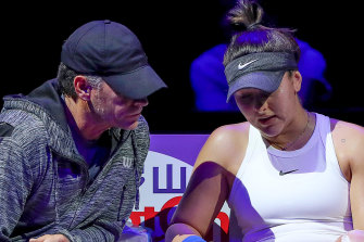 Bianca Andreescu of Canada speaks to her coach Sylvain Bruneau after sustaining an injury to her left leg during a break in her Women's Singles match against Karolina Pliskova of the Czech Republic on Day Four of the 2019 Shiseido WTA Finals at Shenzhen Bay Sports Center on October 30, 2019 in Shenzhen, China.
