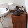 Gorged python chills in Brisbane family's bathroom