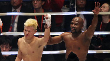 Great champion: Mayweather, left, paid tribute to Tenshin Nasukawa after their lucrative New Year's Eve showdown.