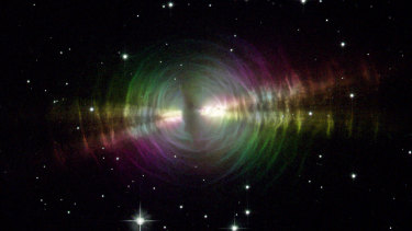 The Egg Nebula is a rapidly evolving pre-planetary nebula spanning about one light year toward the constellation of Cygnus. Thick dust blocks the centre star from view, while the dust shells further out reflect light from this star.