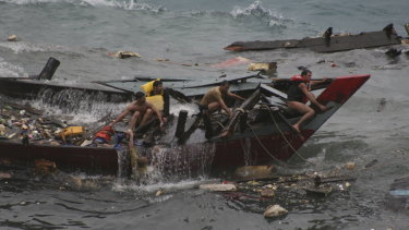 Tragedy ... a boat carrying asylum seekers sinks off Christmas Island in 2010.