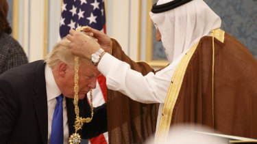 Saudi King Salman presents Donald Trump with The Collar of Abdulaziz al-Saud Medal at the Royal Court Palace last year.