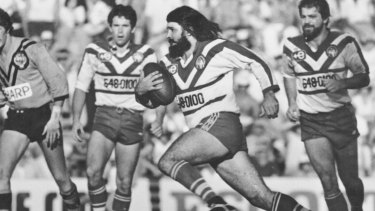 Bulldogs cult hero Geoff Robinson charges at the Balmain defence in the 1980s.
