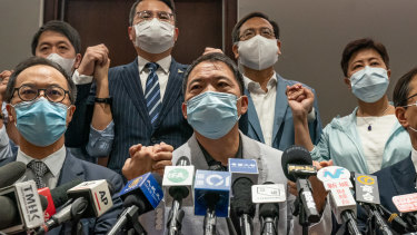 Pro-democracy lawmakers join hands during a press conference at the Legislative Council building on Wednesday..