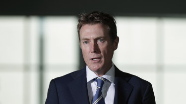 Christian Porter rejected the idea of new workplace laws, but said he would look at the ACTU's proposal for uniform rules regarding notifying authorities of outbreaks.