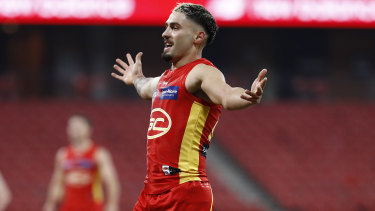 Bound for glory: Gold Coast's Izak Rankine on debut against the Demons.