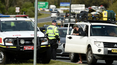 Police check cars for permits at the border checkpoint in Coolangatta at the Gold Coast.