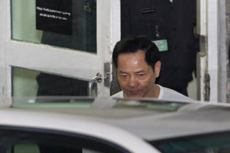 Macau crime boss Wan Kuok Koi, known as Broken Tooth, walks out of Coloane Prison in Macau in 2012.