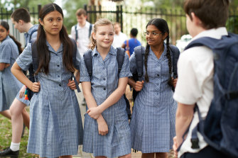 Bradford (played by Evie MacDonald), centre, in First Day on ABC Me.