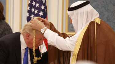 Saudi King Salman presents President Donald Trump with The Collar of Abdulaziz al-Saud Medal at the Royal Court Palace last year.