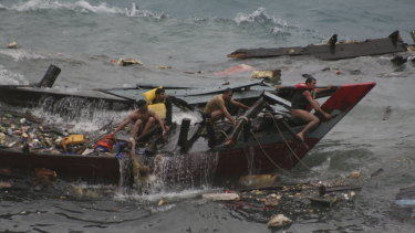 A boat carrying asylum seekers sinks off the coast of Christmas Island in 2010.